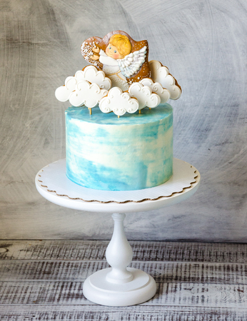 baptizing blue cream cake with gingerbread cookies Stock Photo