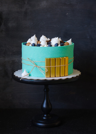 tiffany color cake wrapped in a biscuit tape with golden bricks Stock Photo
