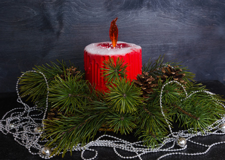Christmas candle cake with caramel flame decorated with pine tree