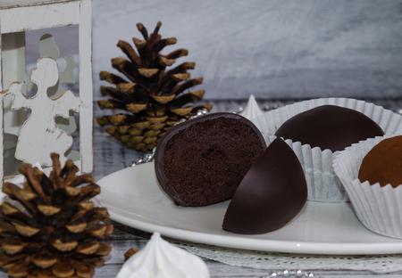 New year chocolate potato cake on wooden background Stock Photo