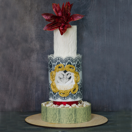 Original wedding two-tiered wedding cake with wafer flowers and birds