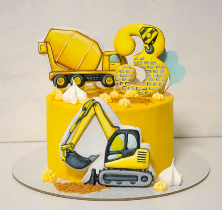Cream cheese yellow cake with gingerbread in shape of cars