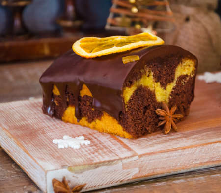 Chocolate orange Christmas cake with fir tree and other decoration