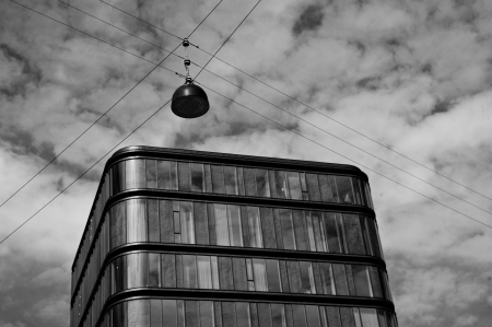 b w: Office building with streetlamp b w