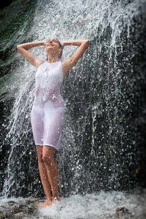 Model shower under waterfall, Calabria - Italy Stock Photo