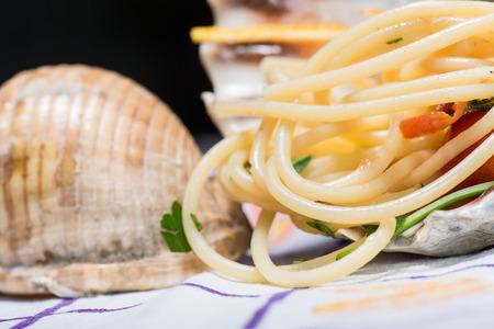 kilos: Italian spaghetti and clams in a large shell Stock Photo