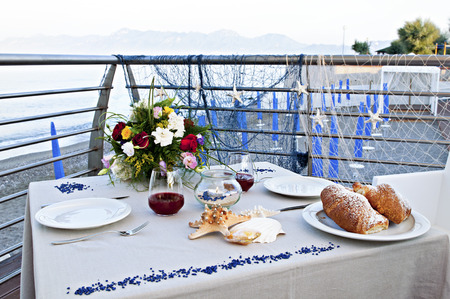 desayuno romantico: romantic breakfast by the sea with croissants, juice and flowers