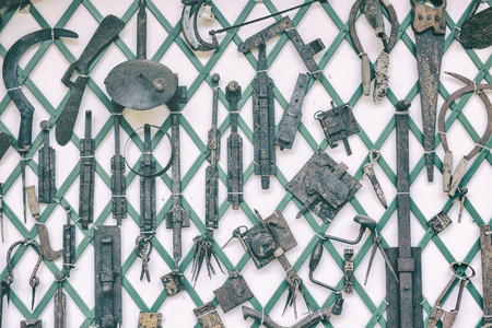fasteners: old garden tools, locks, chains, fasteners, saws Stock Photo