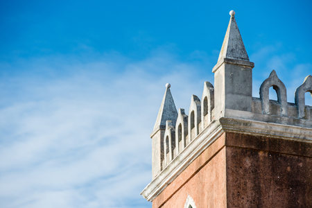 steeples: Various towers and steeples in the city of Venice with blue sky and a few clouds in the sky. All towers and steeples are of historical origin