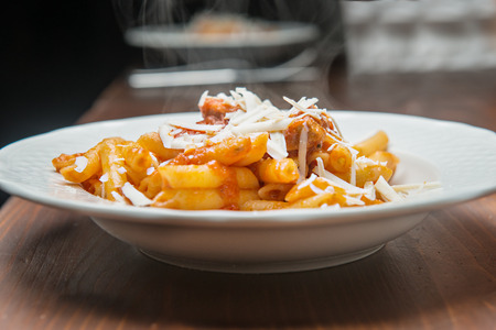 pasta sauce: Pasta, sauce and cheese on wood table