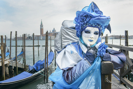 article of clothing: masked man with gondolas and sea