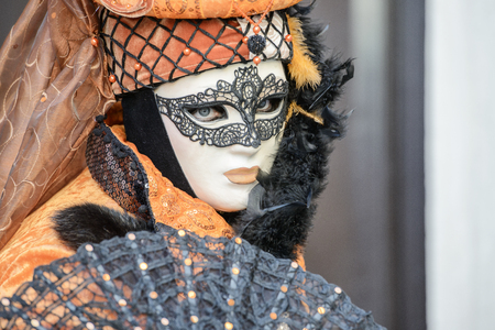 article of clothing: Orange mask with fan