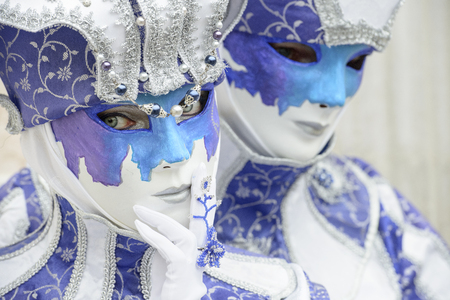 article of clothing: Masked man and woman with blue dress Stock Photo