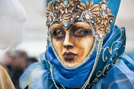 article of clothing: Masked Queen blue and gold