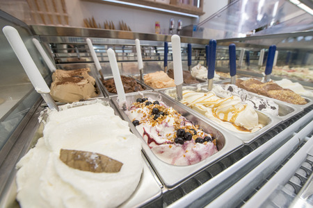 flavors: bowl of ice cream with various flavors, chocolate, cherry, vanilla, nuts, Stock Photo