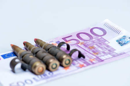 euro notes: small vest rifle bullets with euro notes Stock Photo