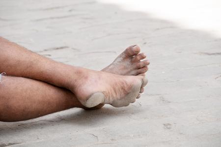 barefoot man: Barefoot man in the street waiting