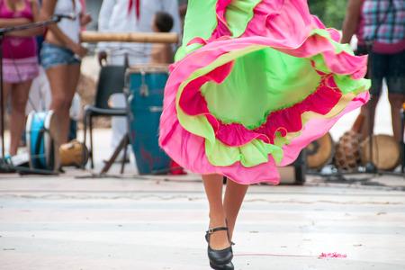 cuba girl: girl dancing old dances with green and orange dress - Havana, Cuba