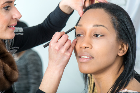 Healthy hair: hair and makeup of a beautiful black girl in studio