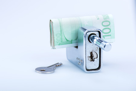 deadbolt: deadbolt with European banknotes and key in still life