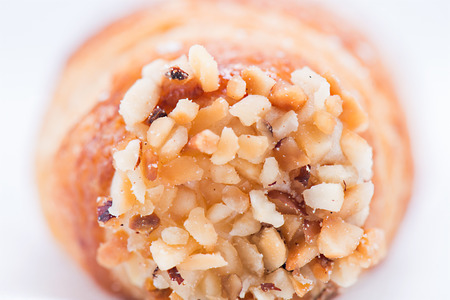 in particular: Sicilian sweet particular, the cannoli, with nuts. In macro Stock Photo