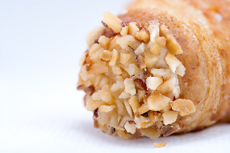 particular: Sicilian sweet particular, the cannoli, with nuts. In macro Stock Photo