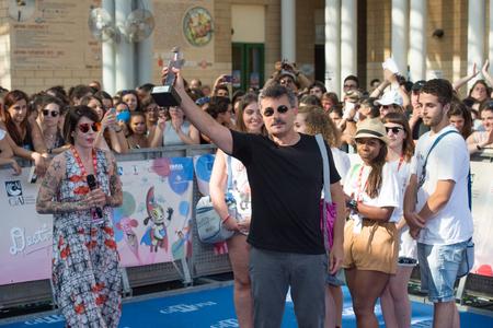 sa: Giffoni Valle Piana, SA, ITALY - July 21, 2016: Director Paolo Genovese on blue carpet interview at Giffoni Film Festival 2016 - on July 21, 2016 in Giffoni Valle Piana, Italy.
