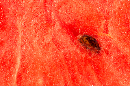 especially: Watermelon especially in close-up, red with white veins and seeds. Stock Photo