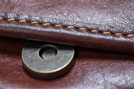 leather bag: Button brown leather bag Stock Photo