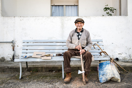 smiled: old man that work in old way on the bench