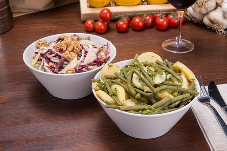 Warm salad of potatoes green beans and asparagus. Rich salad with fennel, parmesan slices and walnuts