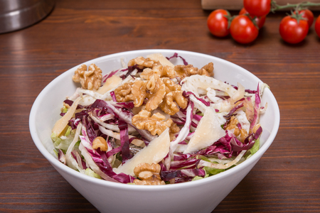 Salad with fennel, parmesan slices and walnuts on italian table Stock Photo
