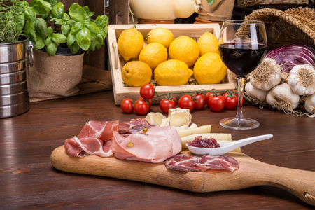 Salami and cheese plate on italian table