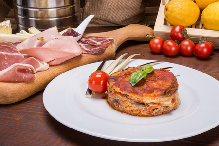 Eggplant parmigiana on table, original italian dish in sicily Stock Photo