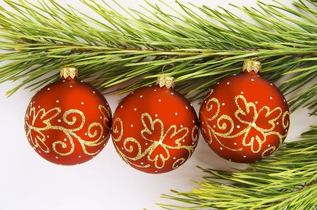 adorning: red balls with pine branch isolated