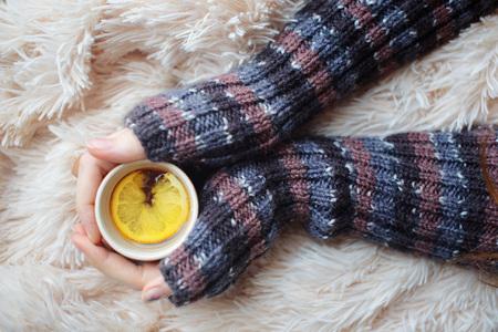 heats: girl heats hands about cup of hot tea