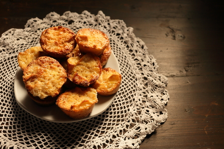 charlotte: Beautiful muffins on a dark wooden background. Vignetting and darkening on the background, light on sweets.