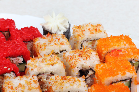 Sushi on a light background, close-up. With caviar of flying fish. Fresh colored sushi. Stock Photo