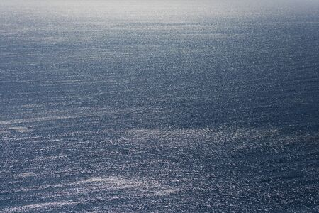 The calm surface of the sea. Sea background.
