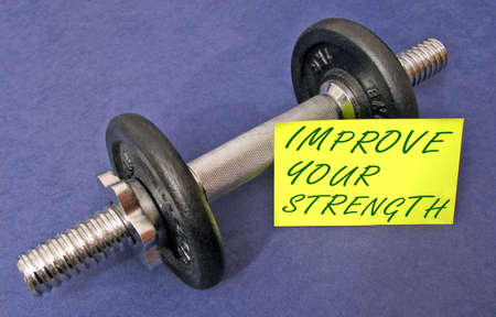 Dumbbell with yellow note