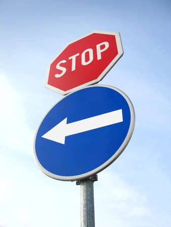 signage outdoor: Stop traffic sign with direction sign