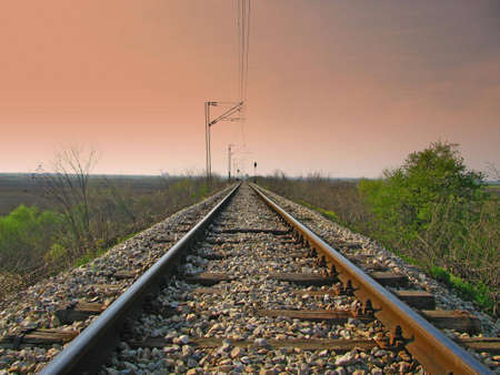 Straight train tracks with dark sky above Stock Photo - 4675874
