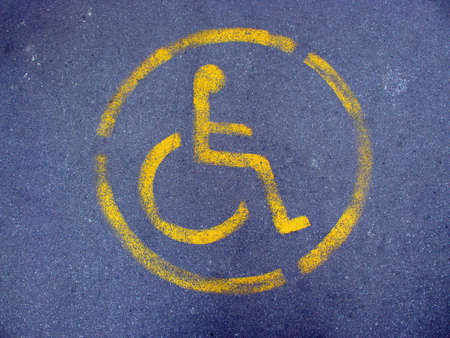 Reserved for disabled sign on pavement photo