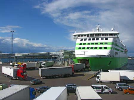 disembark: Trucks boarding ferry
