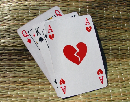 relationship breakup: Three playing cards with broken heart ace