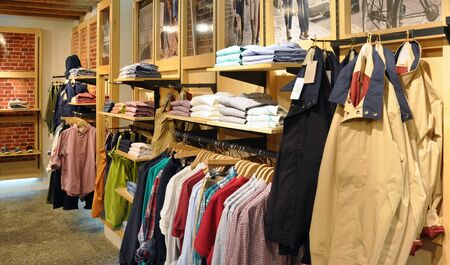 Fashion store interior with casual clothes and shoes