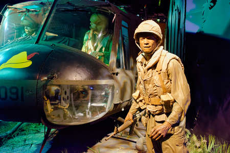 Washington, D.C., USA - November 14, 2017: Life-size diorama showing a scene from the Vietnam War, including the U.S. Bell UH-1 Iroquois 'Huey' helicopter that saw combat in the Vietnam War.