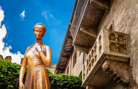 A collage of a bronze statue of Juliet and a balcony juliet Verona Italy Foto de archivo