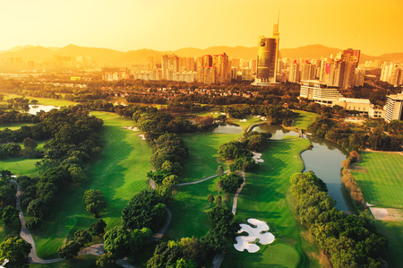 Golf course in the city of Shenzhen in the evening