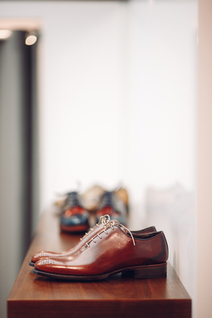 brogues: Closeup of a shelve with male oxfords Stock Photo